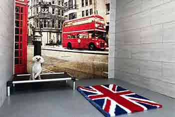 Very large dog room with mural of a red London bus and telephone box, a miniature white Poodle sits on a platform and nearby is a plush Union Jack rug
